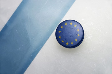 old hockey puck with the national flag of european union