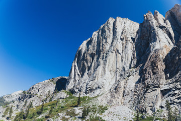 Towering granite mountains surround a deep forested valley in California's Sierra Nevada