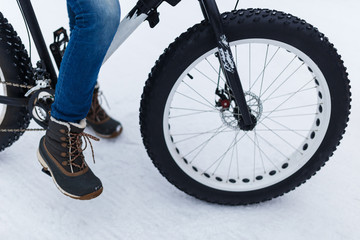Person with bicycle in winter