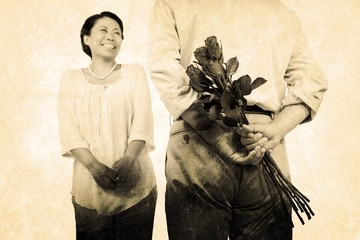 Composite image of man standing with roses by woman