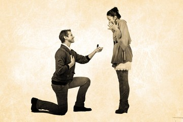 Composite image of man offering engagement ring to partner