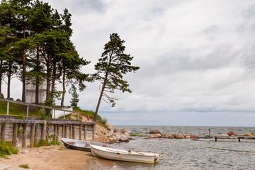 Small fishing boats, on the public beach of Baltic sea, Estonia