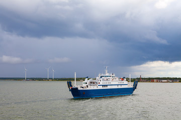 Small passenger ferry in Baltic sea, cloudy weather