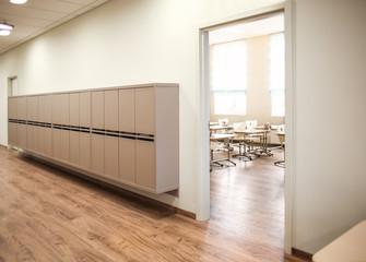 Lockers in empty school hallway
