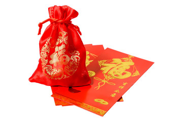 """Red bag and  Red envelope  with text """"Fu"""" meaningful about """"Happiness, Fortune and Money"""" This is one of the most popular Chinese characters used in Chinese New Year. on Isolated white background"""