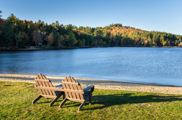 Adirondack Chairs on the Shore of a Beautiful Lake at Sunset
