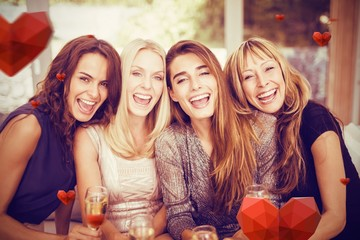 Composite image of portrait of beautiful women having drink