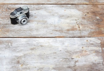 Vintage camera on wood background with copy space.