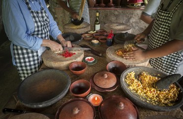 Balinese Cooking Class. Food in Bali is a complicated process with lots of chopping and preparation and mixing of exotic spices. Cooking classes are held in many of the hotels and restaurants.