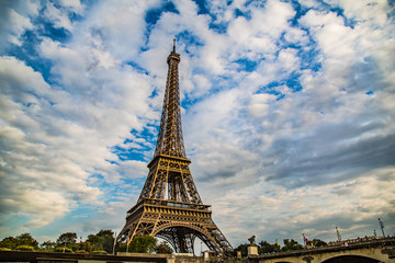 Eiffel Tower set against a cloudy blue sky in Paris, France