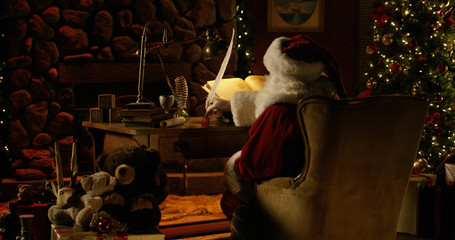 Santa Claus uses a massive quill pen to double-check his naughty list.