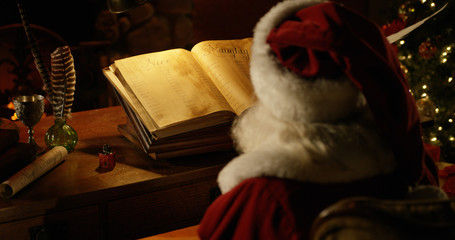 Santa Claus Reading Naughty and Nice List