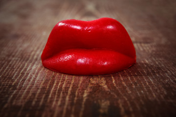 Wax lips on a wooden background