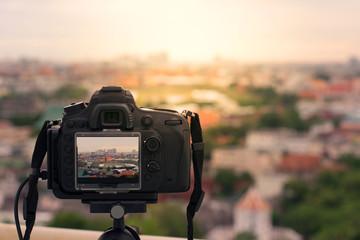 Camera on tripod shooting city scape