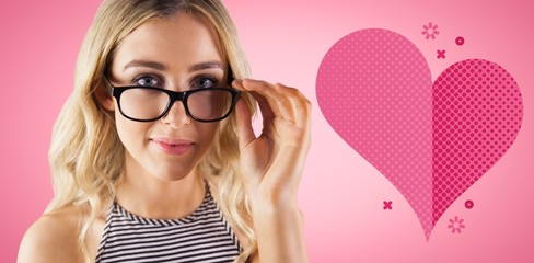 Composite image of gorgeous blonde hipster posing with glasses