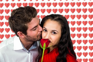 Composite image of man kissing his girlfriend