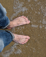 young guy with bare feet on the beach of the Sea of ​​Japan