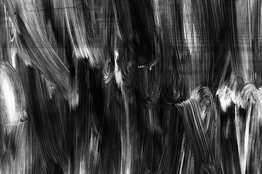 White brush strokes pattern over black wall