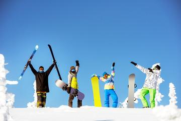Group happy friends snowboard ski concept