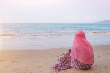 muslim girl look out the sea