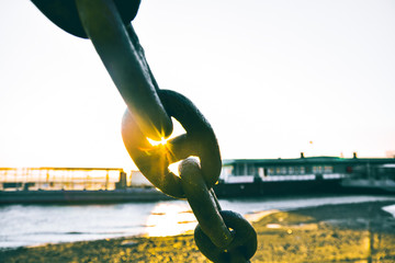 anchor chain on a background of the river bank and bridge