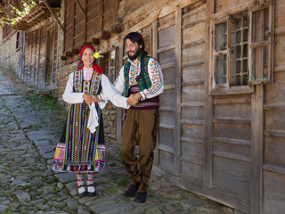 Happy Bulgarian couple dancing