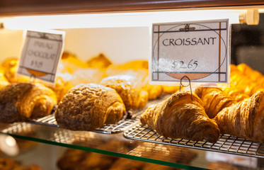 croissant and pain au chocolat in bakery display