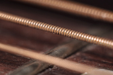 Close-up acoustic guitar dirty strings