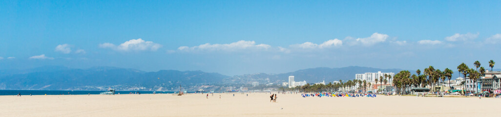 Pacific ocean coastline panorama in Los Angeles USA. People walking at the beach. California beaches panorama.