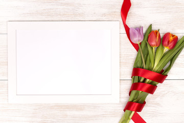 Lilac and red tulips and banner space for text in the white wooden table. Banner template layout mockup for Woman Day, Valentines Day and Teacher's Day.