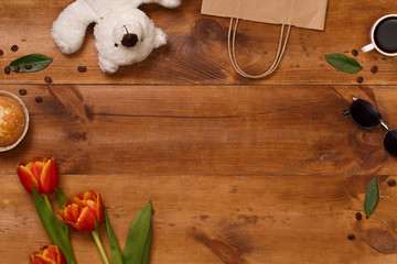 Red tulips and teddy bear in the wooden table. Banner template layout mockup for Woman Day, Valentines Day and Teacher's Day.