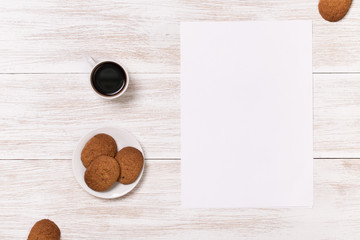 Coffee with biscuits in the white wooden table. View from above with copy space. Photo for posts, blogs, advertising and news. Banner space for text
