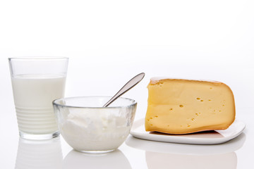 assortment of dairy products ( milk yogurt and cheese )