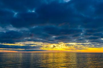 Colorful dramatic sunset above Glenelg Beach