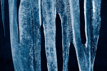 Icicles. Frozen water.