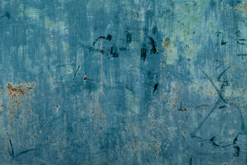 Rusty surface of blue metal plate. Rusty texture backdrop. Rust on old metal. Rust on old blue fence. Grunge ruststained metal fence. Mildew on blue iron-plate fencing. Seedy bingery paling