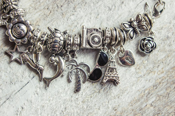 bracelet with pendants charms on the summer theme. Selective focus.