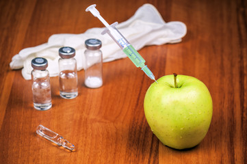 vaccine syringe and apple