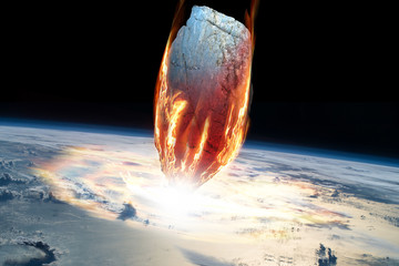 A massive asteroid enters Earth's atmosphere and impacts the planet - Elements of this image furnished by NASA.