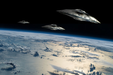 A fleet of flying saucers approach Earth - Elements of this image furnished by NASA.
