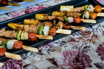 Mini barbecue on black plate