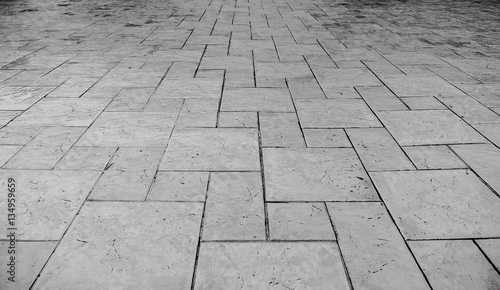 Perspective View Of Monotone Grunge Cracked Gray Brick Marble Stone On The Ground For Street Road