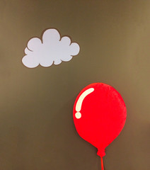 One 3d Red Soft Fluffy Pillow in Shiny Red Balloon Design Style Floating at The Corner with White Cloud and Copyspace on Abstract Dark Brown Wall to input Text