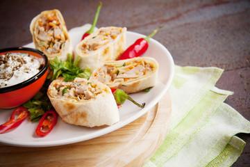 roll of armenian shawarma on plate