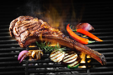 Poster Grill / Barbecue Tomahawk rib beef steak on grill