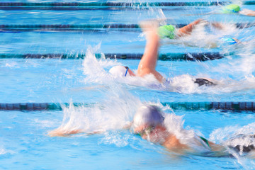 Motion blurred freestyle swimmers in a race