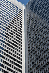 Close up of reflective glass surface of financial building