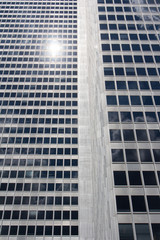 Close up of reflective glass surface of financial buildings