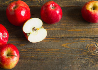 Fresh red apples on wooden table. On wooden background. Free space for text . Top view