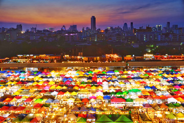 During the twilight of the market with a colorful umbrella. The rear view of the city, in Bangkok, Thailand.